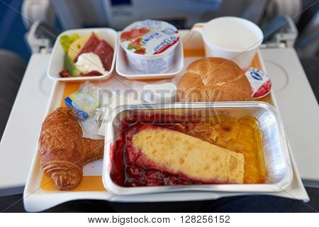FRANKFURT, GERMANY - APRIL 07, 2016: meal at Lufthansa Airbus A320 economy class.  Deutsche Lufthansa AG, commonly known as Lufthansa is a major German airline.