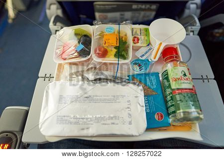 FRANKFURT, GERMANY - MARCH 13, 2016: close up shot of meal at Lufthansa Boeing 747-8 economy class.  Deutsche Lufthansa AG, commonly known as Lufthansa is a major German airline.