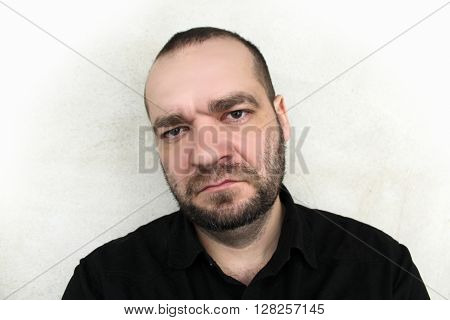 Portrait of angry man on a gray background