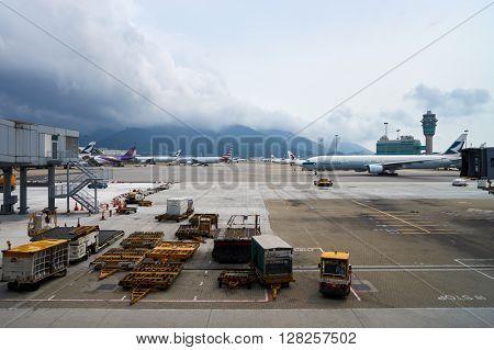 HONG KONG - APRIL 09, 2016: Cathay Pacific aircraft in Hong Kong Airport. Cathay Pacific is the flag carrier of Hong Kong