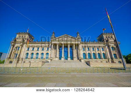 BERLIN, GERMANY - JUNE 06, 2015: Dem Deutschen Volke, is the inscription outside of the Reichstag buiding on Berlin