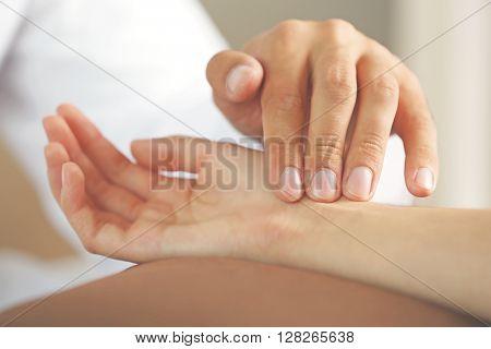 Checking pulse, close up