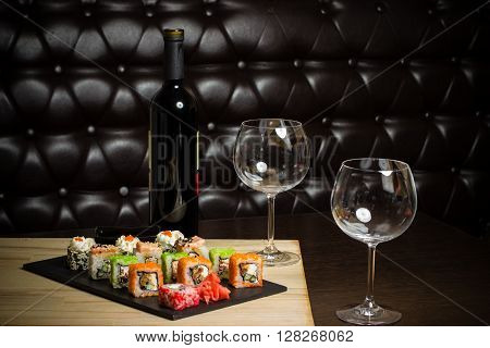 sushi mix served dinner with wine on table at restaurant evening date in cosy room food photography