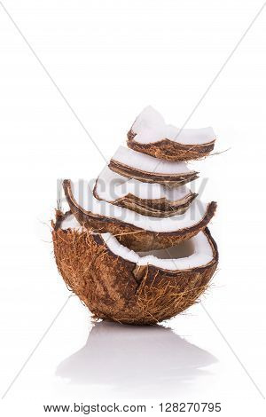 Old Brown Organic Coconut Fruit Broken Into Pieces And Stacked