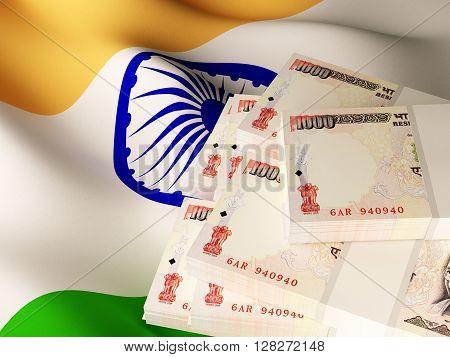 Indian rupee banknote bundles on textile textured Indian flag. 3d rendering.
