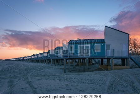Dawn and holiday houses on the bay.