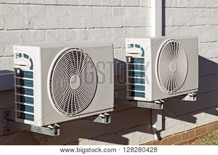 Two newly installed airconditioning units mounted on wall