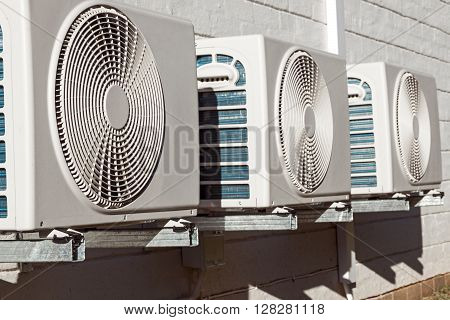 Newly Installed Airconditioning Units Mounted On Brick Wall