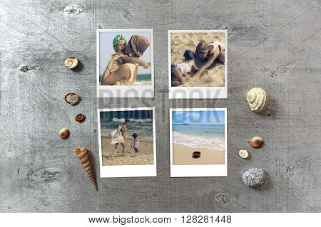 Beautiful seaside snapshots arranged on rustic wooden background with seashells around with copy space top view