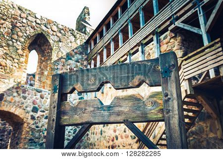 Wooden Medieval Torture Device, Ancient Pillory In Old Castle.