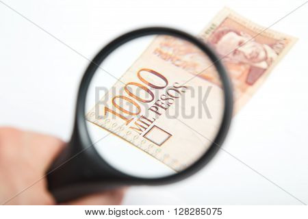 Magnifying Glass on the National Colombian Pesos.