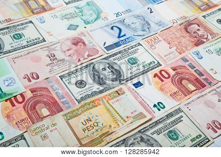 Background from paper money of the different countries. American dollars in the middle
