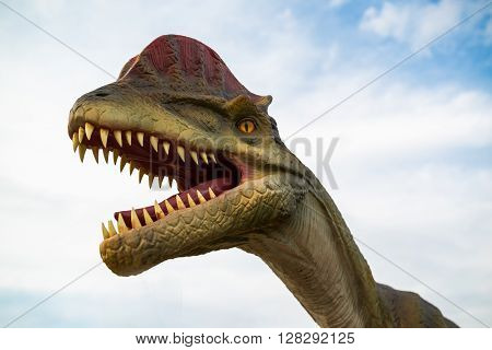 NOVI SAD SERBIA - APRIL 28 2016: Dilophosaurus life-size model of prehistoric animal in theme entertainment Dino Park in Novi Sad Serbia. To date dilophosaurus has been largest meat-eater of the early Jurassic period found.