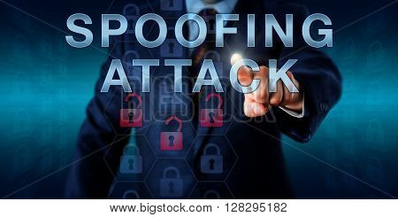 Cyber investigator is pressing SPOOFING ATTACK on a visual touch screen interface. Information technology concept for falsification of data allowing an attacking user to masquerade as another user.