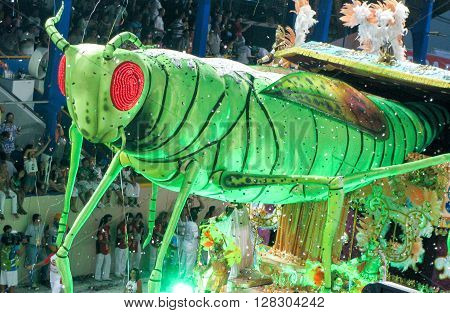 Rio de Janeiro Brazil - February 23: amazing extravaganza during the annual Carnival in Rio de Janeiro on February 23 2009 - giant figure of grasshopper