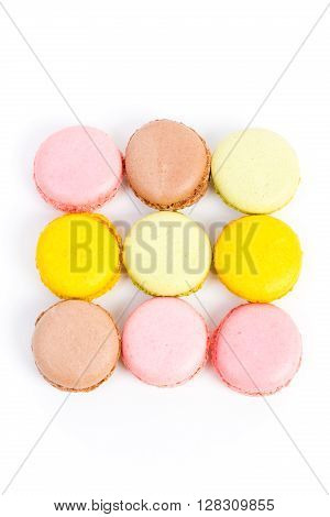some sweet colorful biscuits against white background