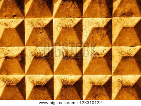 cracked gold slab with rhombus texture. Grunge background.