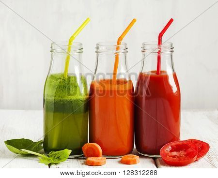 Fruits and vegetable juice in bottle: Apple and spinach juice Carrot juice and Tomato juice