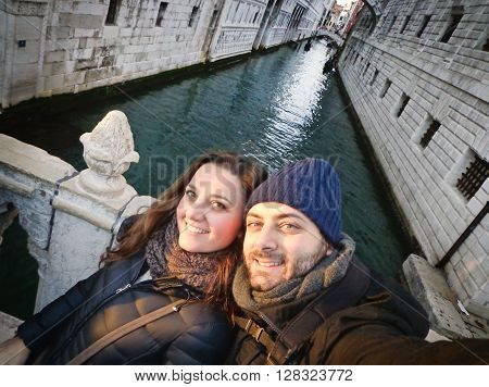 Young Couple While Taking A Selfie In Venice