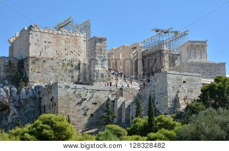 ATHENS, GREECE - OCTOBER 18: Propylaea ancient gate at the entrance of the famous Acropolis of Athens under repairs OCTOBER 18, 2014 in Athens, Greece