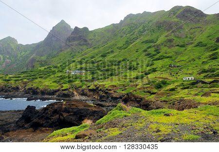 Homes, Bay And Mountain Range