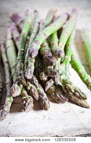fresh asparagus closeup on wooden table