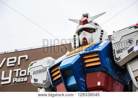 Tokyo Japan - April 8 2016: Full size Gundam RX78 in ratio 1:1 Performances at DiverCity Tokyo Plaza Odaiba Tokyo Japan - It is 18m tall The sculpture of famous anime franchise robot.