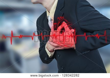 businessman having heart attack insurance health concept