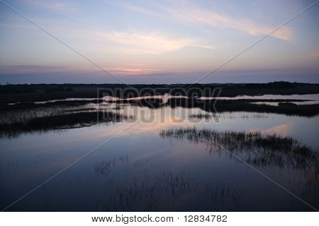 Sky reflecting in water in marsh area on Bald Head Island, North Carolina.