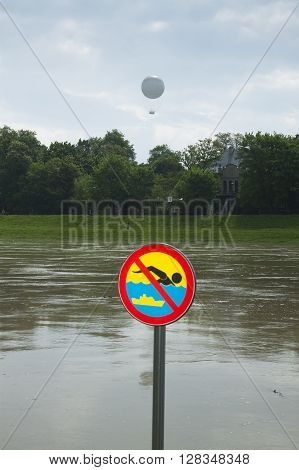 Poland Krakow flooded Vistula/Wisla river embankments no swimming sign over the water sightseeing baloon in the background poster