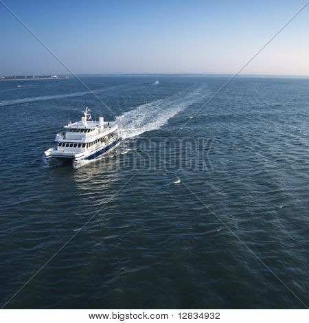 Aerial view of passenger ferry boat in open waters near Bald Head Island, North Carolina.