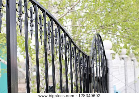 Iron gate with sequences of spikes and lines poster