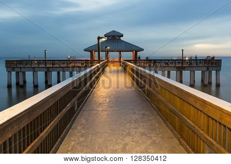 Evening light on the fishing pier in Fort Myers Beach Florida.
