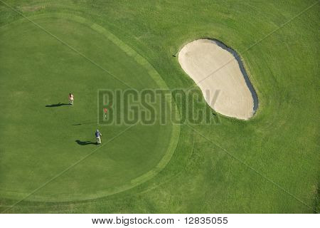 Aerial view of two people playing golf at Bald Head Island, North Carolina.