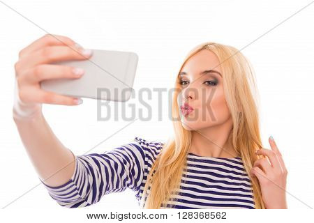 Pretty Woman  Making Selfie On Her Smartphone And Pouting
