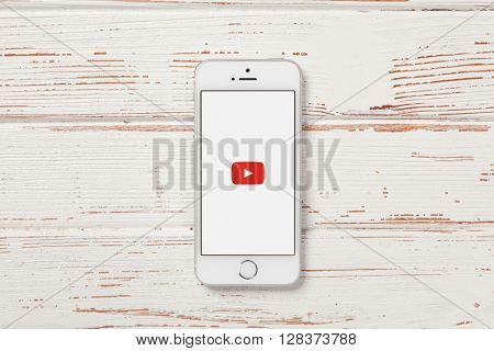 WROCLAW, POLAND - APRIL 12, 2016: Apple iPhone SE smartphone with Youtube app on screen