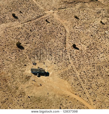Aerial of trailer home in Arizona desert.
