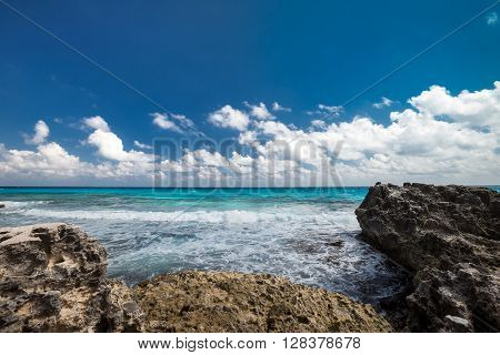 Ocean With Waves And Rocks On Beach