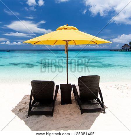 Sun Umbrella And Beach Beds On  Beach