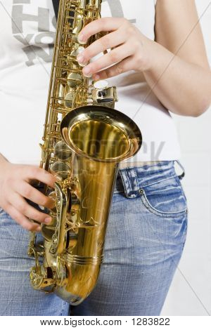 young saxophone player with white t-shirt and jeans. poster