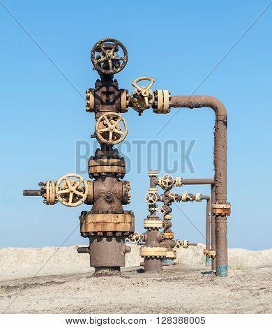 Wellhead with valve armature. Oil gas industry.