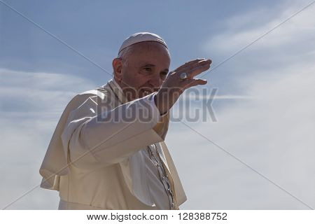 Rome Italy - April 30 2016: Pope Francis on board for ships of the Pope-mobile runs through St. Peter's Square waving to the crowd around him on the occasion of the day dedicated to the jubilee of the military family and police.