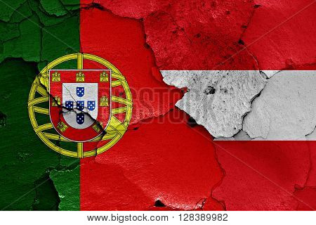flags of Portugal and Austria painted on cracked wall
