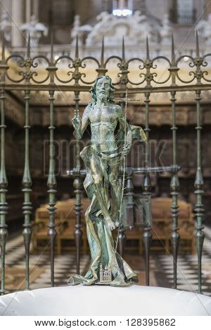 Jaen - Spain, may 2016, 2: Sculpture of risen Jesus made in bronze, located at the entrance of the baptistery in the entrance area to the choir stalls, opposite the high altar of the Cathedral, take in Jaen, Spain
