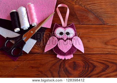 Felt owl embellishment. Felt owl toy. Kids DIY crafts. Sheets of colored felt, scissors, thread, needle poster