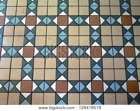 Tiled mosaic floor in Madrid Metro Station