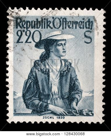 ZAGREB, CROATIA - SEPTEMBER 06: A stamp printed in Austria shows image woman in national Austrian costumes, Ischl, 1820, series, circa 1952, on September 06, 2014, Zagreb, Croatia