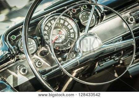 retro styled classic car steering wheel and dashboard dials