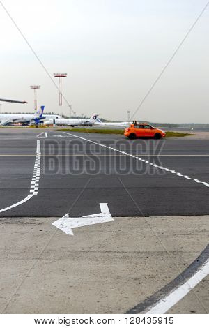 The Intersection Of The Taxiway For Airplanes And Tracks