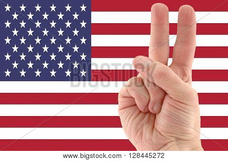 photo of American flag and victory hand sign